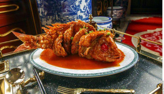 Suculento pescado huachinango marinado con una salsa agridulece.(xxxxxx)