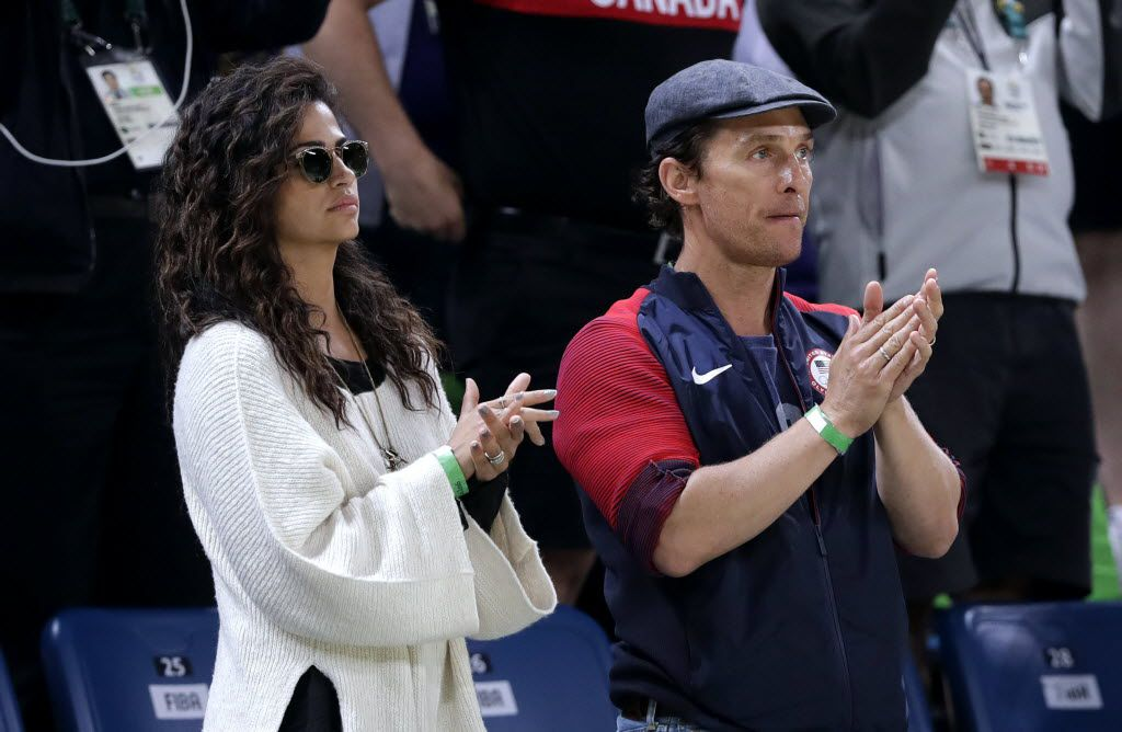 Actor Matthew McConaughey and his wife Camila Alves watch a basketball game between the United States and Australia at the 2016 Summer Olympics in Rio de Janeiro, Brazil, Wednesday, Aug. 10, 2016.