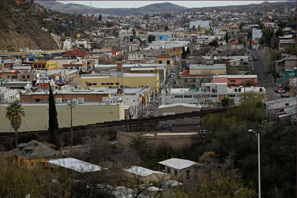 A razor-wire-covered border wall separates Nogalas, Mexico, in the distance, and Nogales, Ariz. Saturday, March 2, 2019.