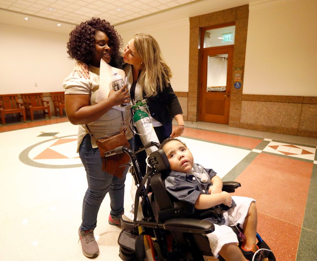 Linda Badawo of Mesquite, Texas (left) receives a hug from Flower Mound mother Hannah Mehta of TX Fragile Kids following her testimony at the Texas House Committee on Human Services, Wednesday, June 20, 2018.