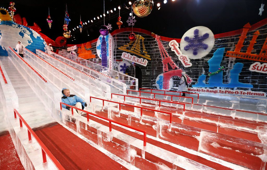 Visitor Mark Haug slides down on the ice slide at the Ice! exhibit at the Gaylord Texan Resort & Convention Center in Grapevine.