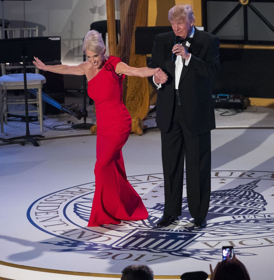 President-elect Donald Trump brings Kellyanne Conway, his campaign manager and adviser, on stage for a bow during a dinner on the eve of his inauguration, at Union Station in Washington, Jan. 19, 2017.