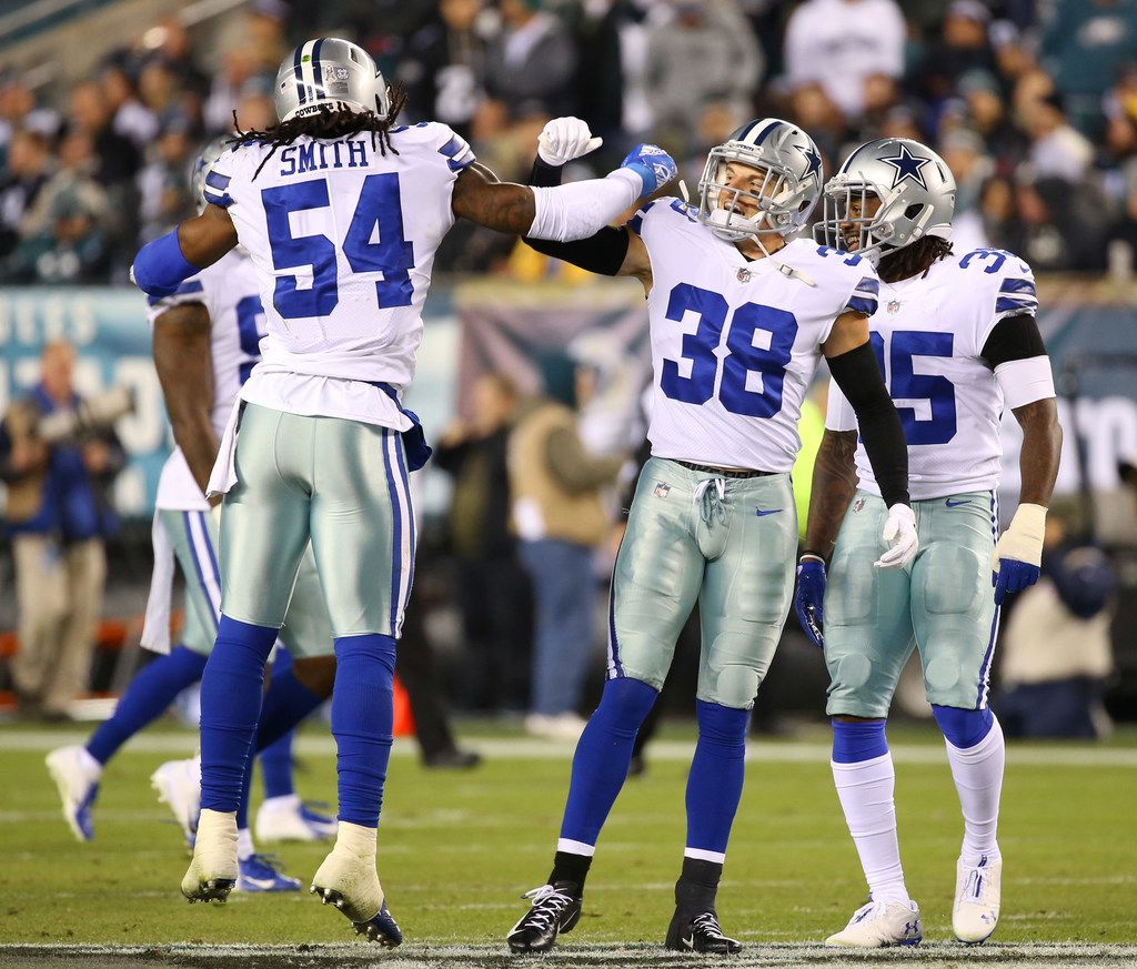 Dallas Cowboys middle linebacker Jaylon Smith (54) celebrates with Dallas Cowboys strong safety Jeff Heath (38) after shutting down the Philadelphia Eagles offense in the second quarter at Lincoln Financial Field in Philadelphia, Penn. on Sunday, Nov. 11, 2018. (Rose Baca/The Dallas Morning News)