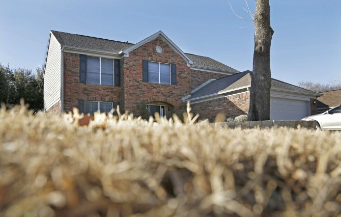 Crime scene investigators were at the Wilner home in the 1500 block of River Birch Drive in Flower Mound on Tuesday.