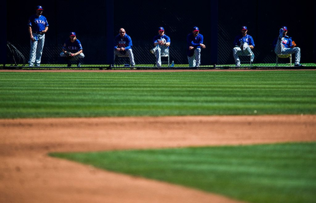 Texas Rangers watch the second inning of a spring training game against the Seattle Mariners from the bullpen on Sunday, March 5, 2017 at the Peoria Sports Complex in Peoria, Arizona. (Ashley Landis/The Dallas Morning News)