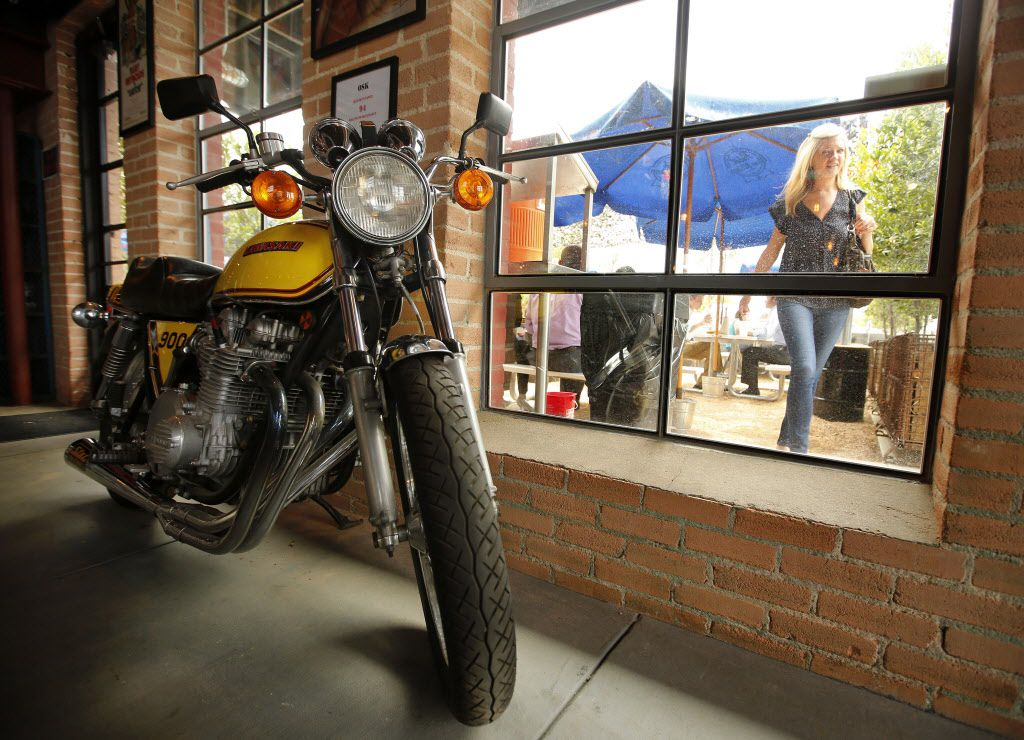 A 1979 Kawasaki 900 motorcycle  parked inside Off-Site Kitchen belongs to owner Nick Badovinus.