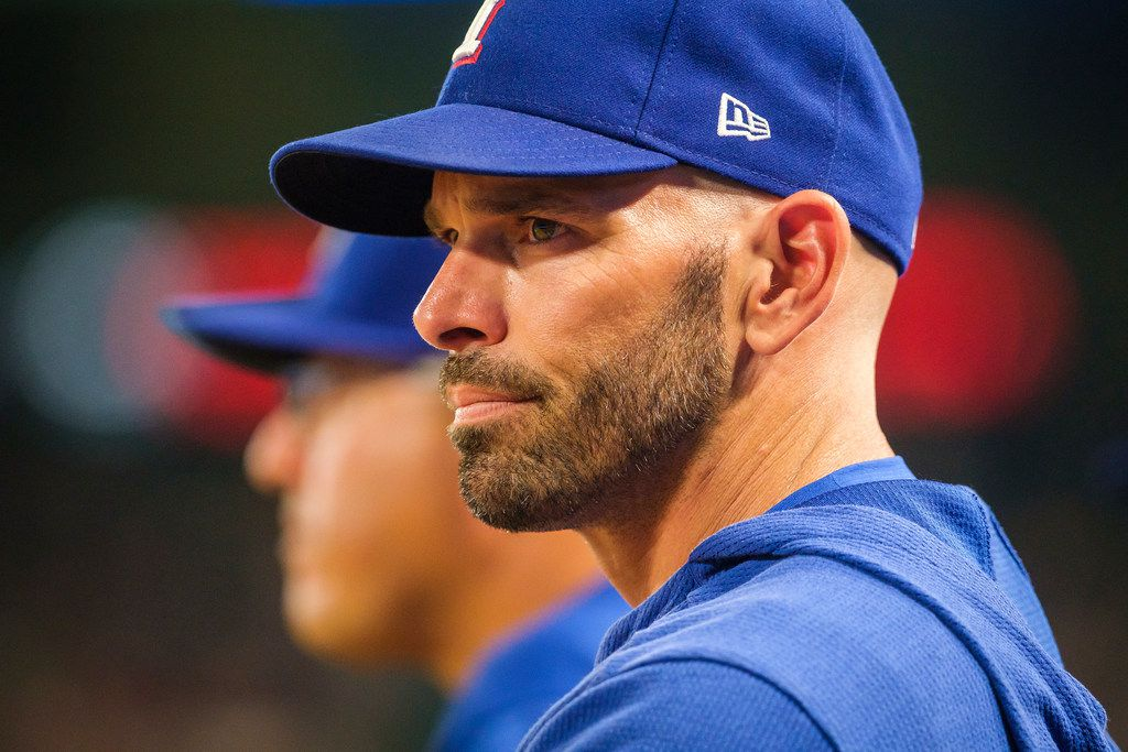 Texas Rangers manager Chris Woodward watches from the dugout during the eighth inning against the Detroit Tigers at Globe Life Park on Friday, Aug. 2, 2019, in Arlington. (Smiley N. Pool/The Dallas Morning News)