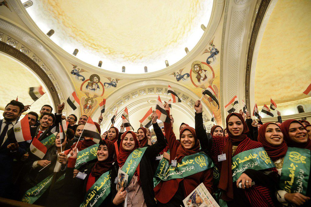 Egyptian Muslim Students attend a Christmas Eve mass in Egypt's New Administrative Capital.