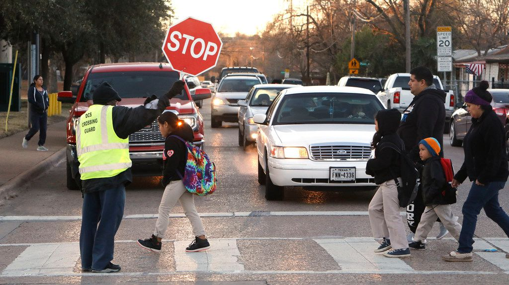 Russell Roberson, 77, helped students and parents cross the street at Lorenzo De Zavala Elementary School in Dallas in January.