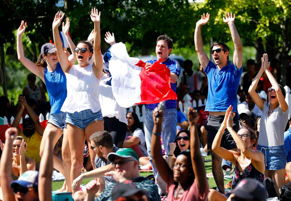 French soccer fans celebrate a first half goal during a World Cup watch party at Klyde Warren Park in Dallas, Sunday, July 15, 2018. The group of Southwest Airlines and Amadeus employees cheered on France to defeat Croatia, 2-1, in the championship game. (Tom Fox/The Dallas Morning News)