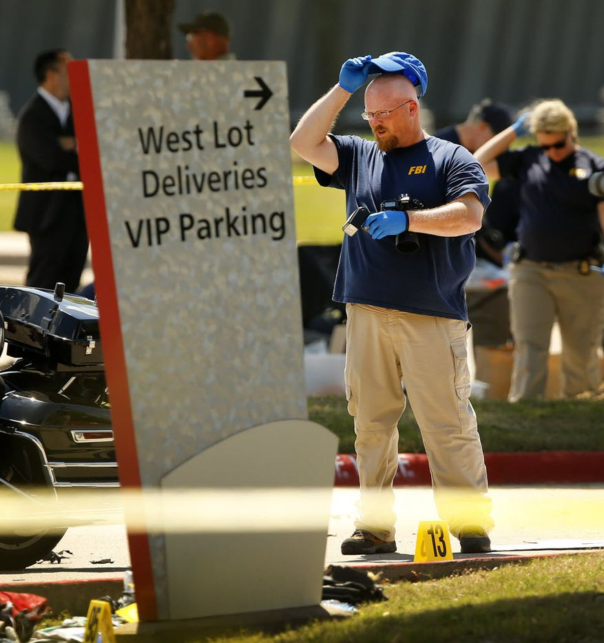 Members of the FBI Evidence Response team document the crime scene on May 4, 2015, after two gunmen armed with assault rifles and wearing body armor opened fire on an unarmed Garland ISD security guard outside the Curtis Culwell Center in Garland.