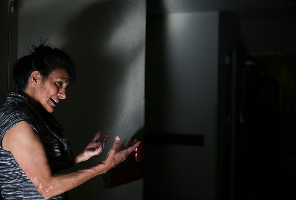 """Elisa Ornales speaks with migrants before they are relocated out of an Annunciation House shelter on Friday, March 29, 2019 in El Paso, Texas. """"Whatever is needed, we have to step up to the plate and take care of people. We're all the same,"""" Ornales said."""