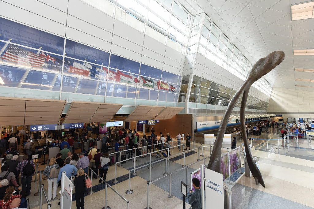 Passengers pass through security at Terminal D at Dallas/Fort Worth International Airport. Because of growth at the airport, officials are beginning to discuss plans for a sixth terminal.