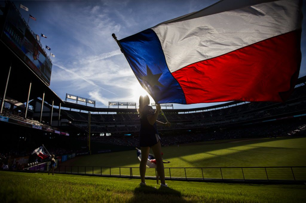 Texas Rangers Six Shooter Jaime Thatcher waves a Texas flag in the outfield before their game against the Houston Astros on Wednesday, June 8, 2016, at Globe Life Park in Arlington, Texas. (Ashley Landis/The Dallas Morning News)