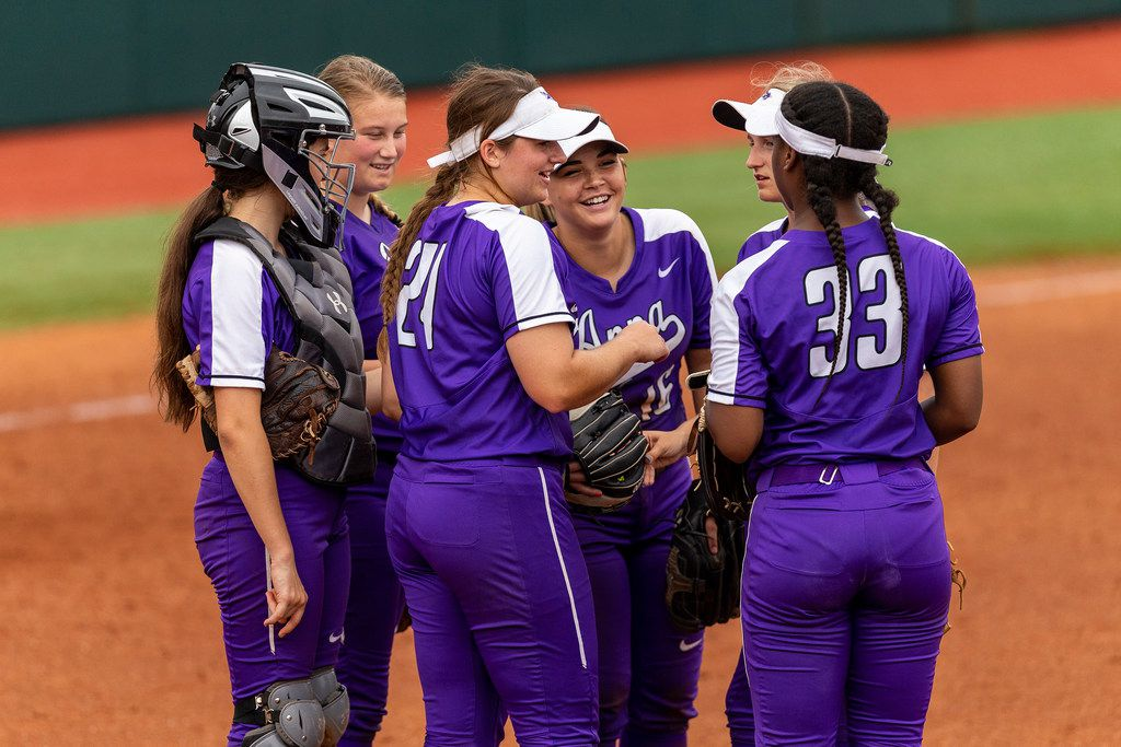 Members of the Anna high school team gather in the circle as they compete against Decatur during the UIL Class 4A state softball semifinal in Austin, Thursday, May 30, 2019. (Stephen Spillman/Special Contributor)