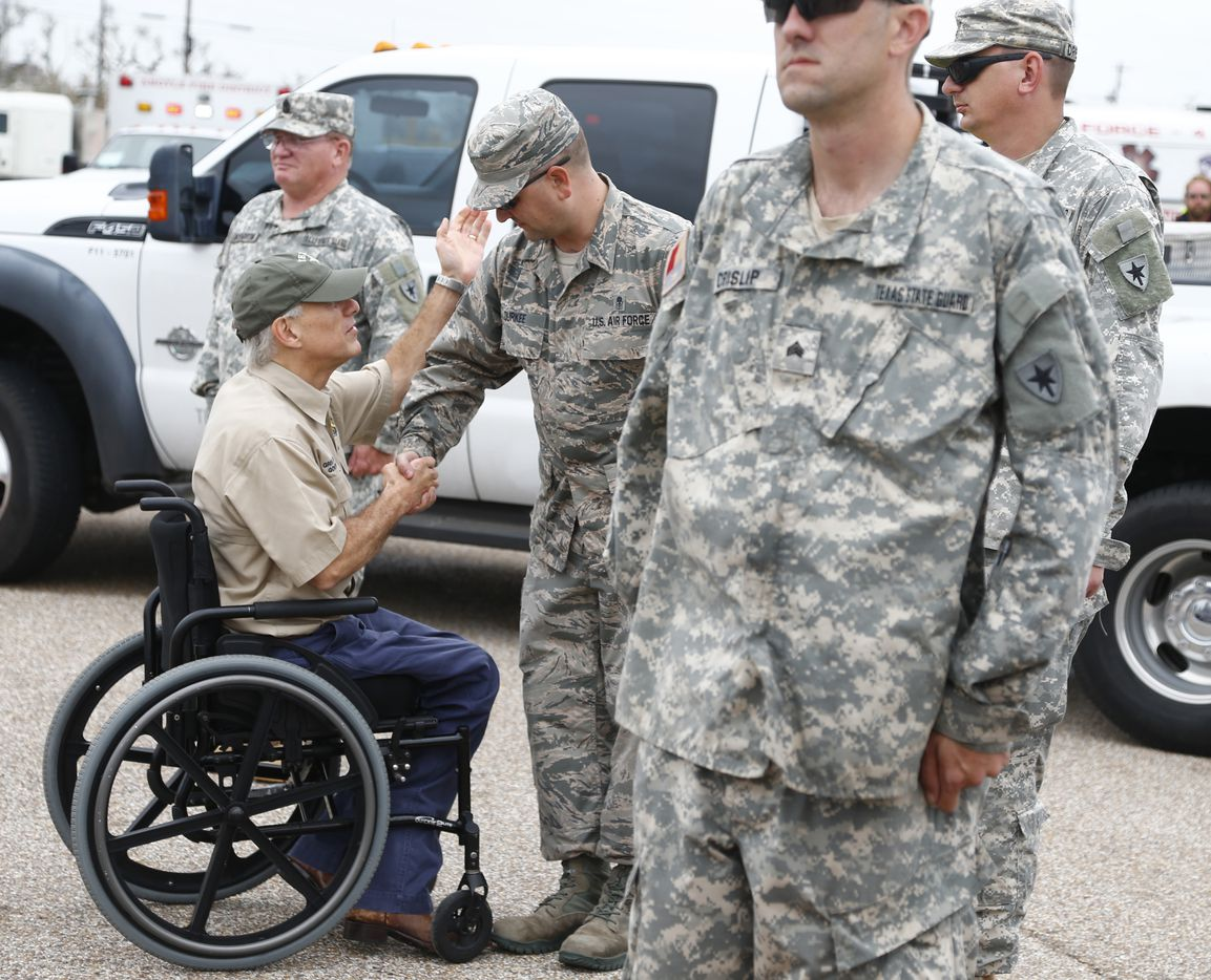 Texas Gov. Greg Abbott shakes hands with National guardsmen after Hurricane Harvey as he visits Rockport, Texas on Aug. 28, 2017.