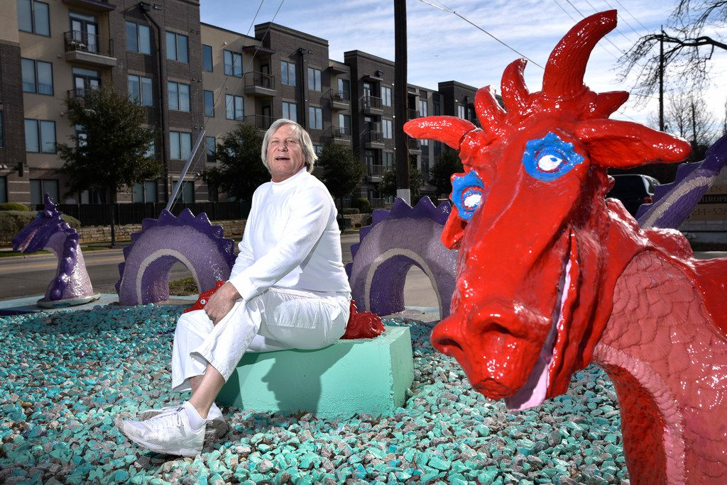 Dr. Steven Tutt and his dragons outside of his office at Cedar Springs Chiropractic in Dallas on Jan. 28, 2019.