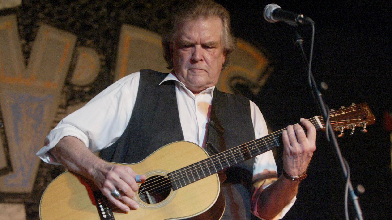 Guy Clark performs at Poor David's Pub during the opening night at the club's new site on South Lamar.