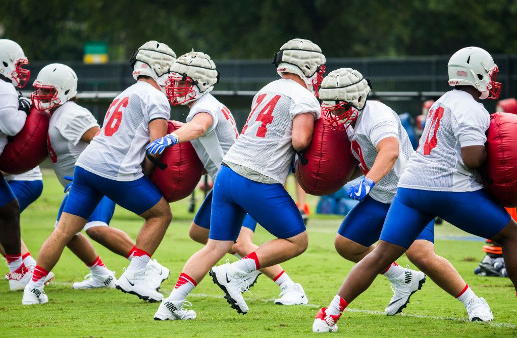 Football players work out during SMU's first football practice of the season on Tuesday, August 1 , 2017 at the SMU practice fields in Dallas.  (Ashley Landis/The Dallas Morning News)