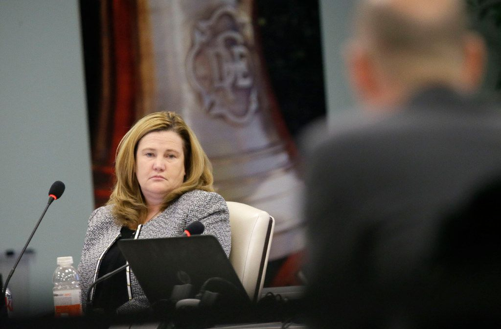 Kelly Gottschalk, executive director of the Dallas Police and Fire Pension System, listens during a pension board of trustee meeting in Dallas, Thursday, Dec. 8, 2016. The board is expected to decide whether to stop lump sum withdrawals from the ailing fund. (AP Photo/LM Otero)
