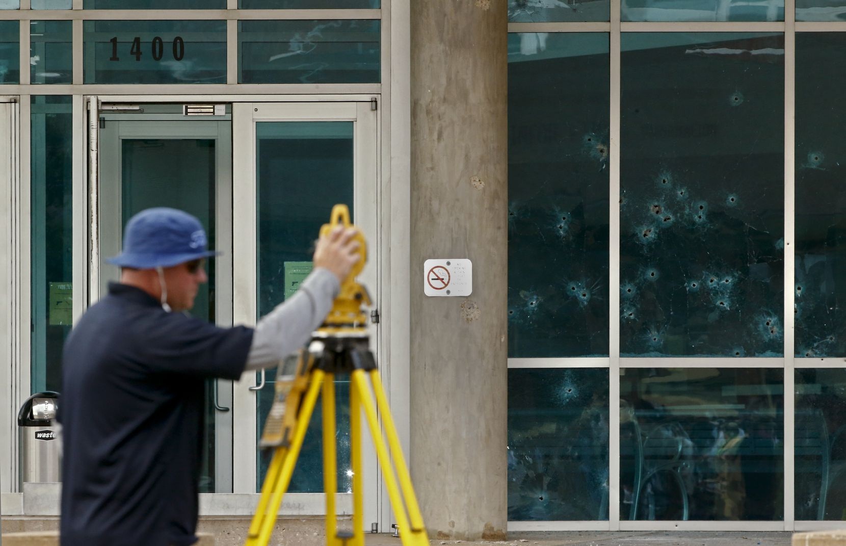 Bill Smith with the FBI uses a 3d imagingin system to map out the crime scene during a guided tour of the path of a shooting and bombing at Dallas Police Department's headquartes on Lamar in Dallas Saturday June 13, 2015.. (Nathan Hunsinger/The Dallas Morning News)