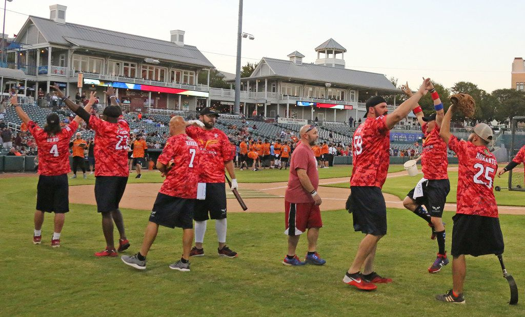 The Oklahoma University team celebrates their win during the Red River celebrity home run contest at the Dr. Pepper Ballpark in Frisco, Texas. (Louis DeLuca/The Dallas Morning News)
