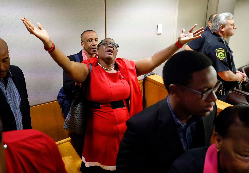 Botham Jean's mother, Allison Jean, rejoices in the courtroom after fired Dallas police Officer Amber Guyger was found guilty of murder by a 12-person jury in the 204th District Court at the Frank Crowley Courts Building in Dallas on Oct. 1.. Guyger shot and killed Botham Jean, an unarmed 26-year-old neighbor in his own apartment last year. She told police she thought his apartment was her own and that he was an intruder. (Tom Fox/The Dallas Morning News/Pool)