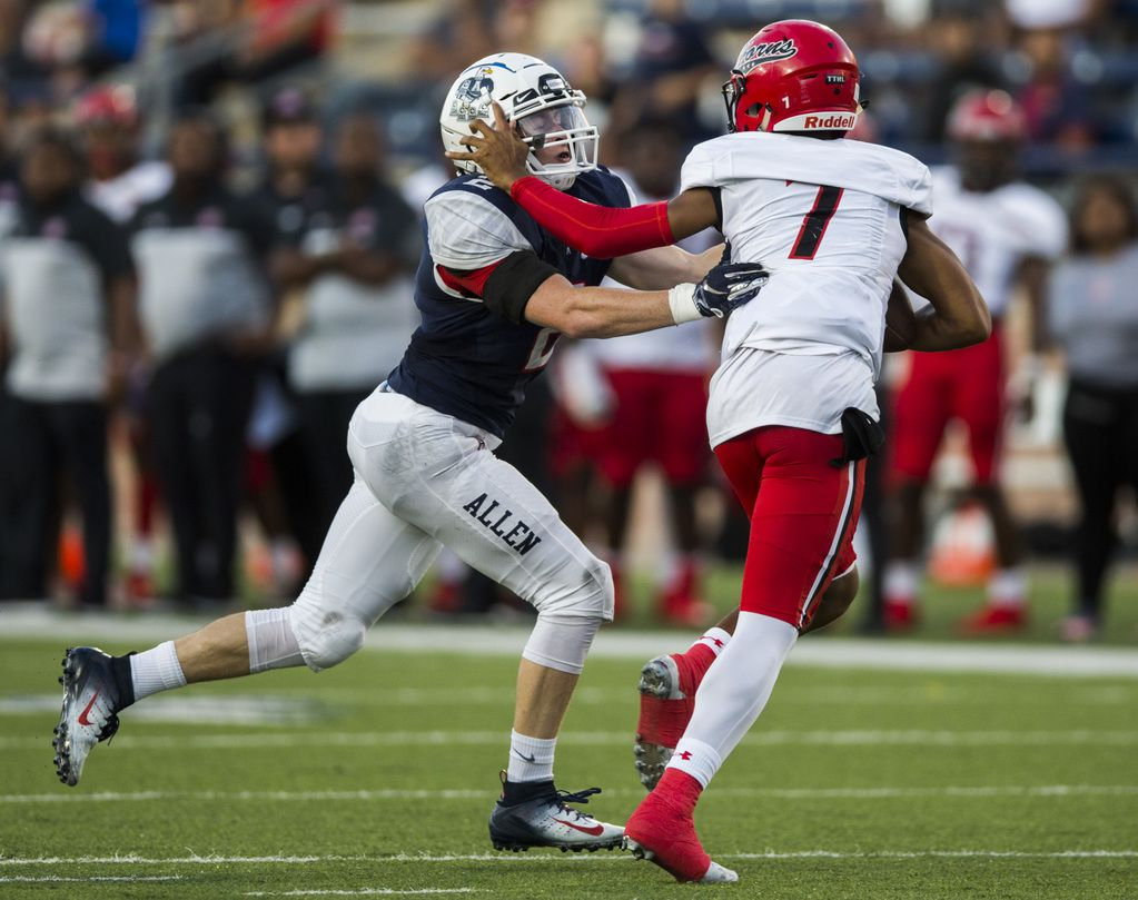 Cedar Hill quarterback Kaidon Salter (7) is sacked by Allen linebacker Jaden Healy (2) during the first quarter of a high school football game between Allen and Cedar Hill on Friday, August 30, 2019 at Eagle Stadium in Allen. (Ashley Landis/The Dallas Morning News)