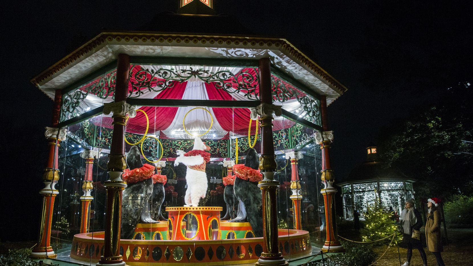 Visitors walk past the Five Golden Rings gazebo at Holiday at the Arboretum, featuring The 12 Days of Christmas on Tuesday, November 12, 2019 at the Dallas Arboretum in Dallas. (Ashley Landis/The Dallas Morning News)