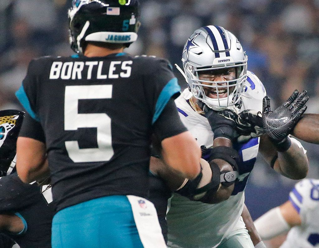 FILE - Dallas Cowboys defensive tackle David Irving (95) rushes Jacksonville Jaguars quarterback Blake Bortles (5) in the fourth quarter during the Jacksonville Jaguars vs. the Dallas Cowboys NFL football game at AT&T Stadium in Arlington, Texas on Sunday, October 14, 2018. (Louis DeLuca/The Dallas Morning News)