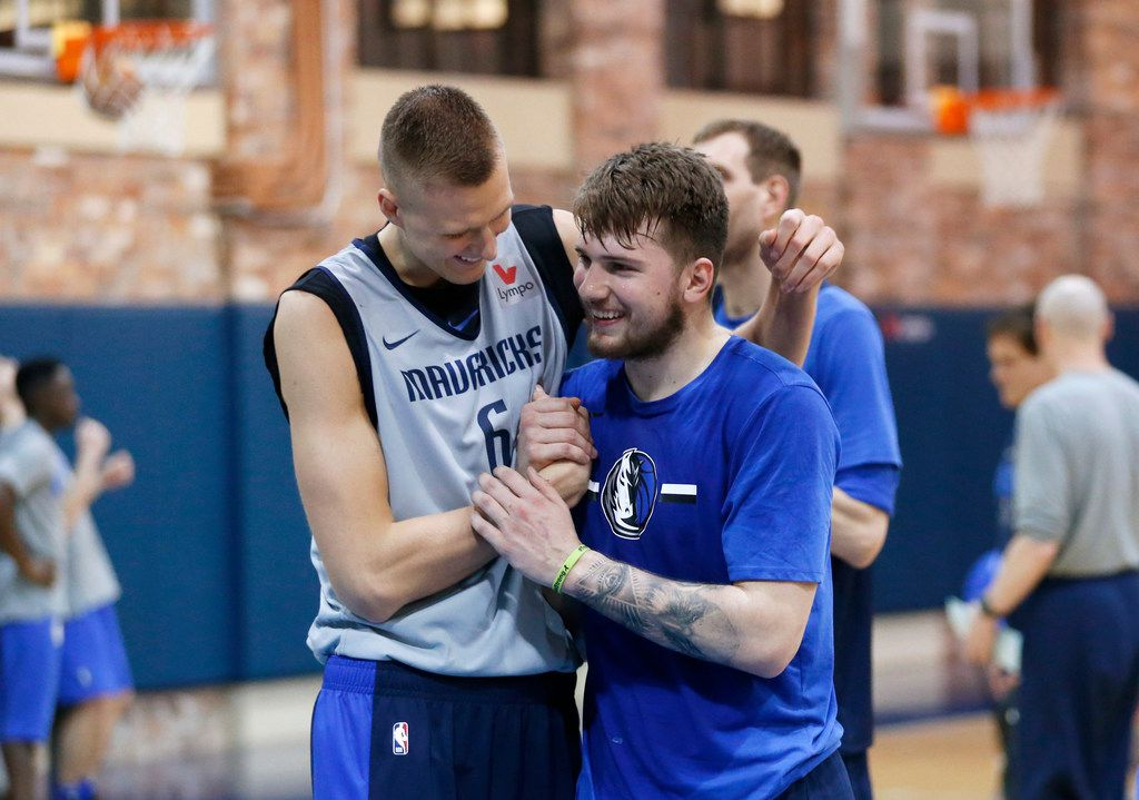 Dallas Mavericks forward Kristaps Porzingis (6) and Dallas Mavericks forward Luka Doncic (77) meet after practice at American Airlines Center in Dallas on Monday, February 4, 2019. (Vernon Bryant/The Dallas Morning News)