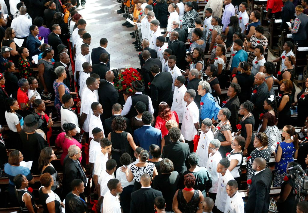 Botham Jean is carried by pallbearers and followed by family at the start of the funeral at Minor Basilica of the Immaculate Conception in Castries, St. Lucia on Sept. 24, 2018. Jean was shot and killed in his apartment by off-duty Dallas police officer Amber Guyger.
