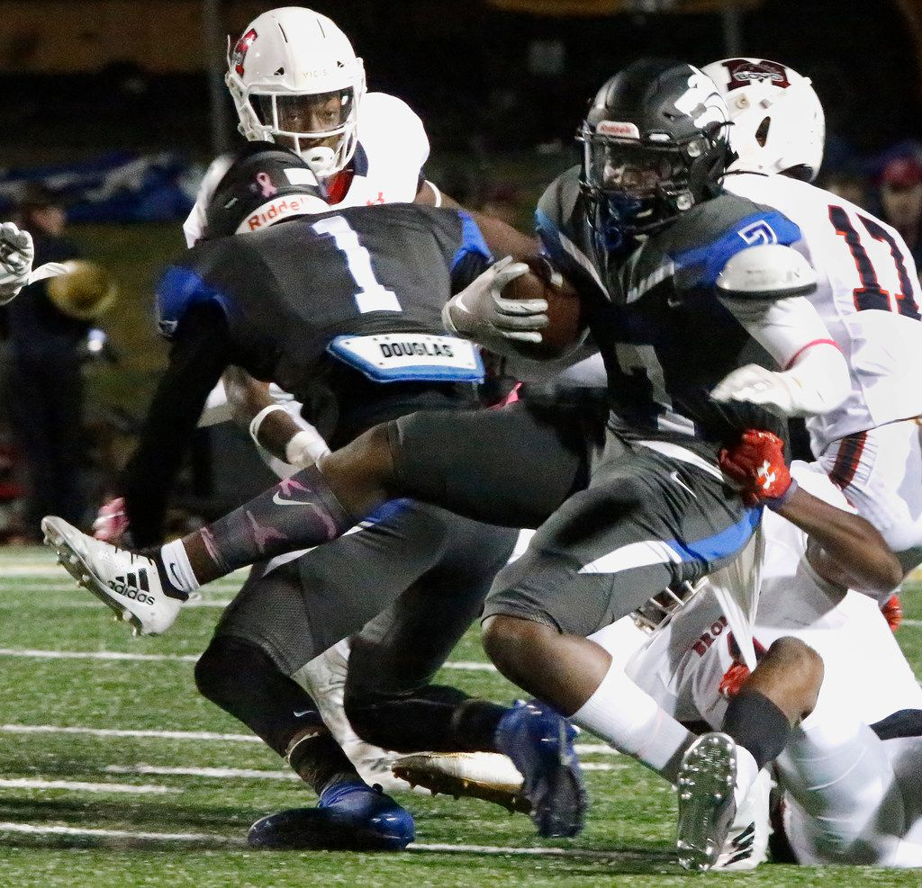 Plano West High School running back Tabron Yates (7) is tackled by McKinney Boyd High School outside linebacker Javon Matthews (1) during the first half as Plano West High School hosted McKinney Boyd High School at Clark Stadium in Plano on Friday night, October 11, 2019. (Stewart F. House/Special Contributor)