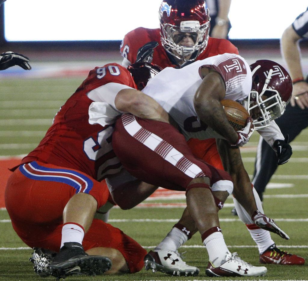 Southern Methodist Mustangs defensive end Zach Wood (90) and linebacker Jeremy White (16) sack Temple Owls running back Jahad Thomas (5) at Gerald J. Ford Stadium on November 6, 2015 in Dallas, Texas.   (Nathan Hunsinger The Dallas Morning News)