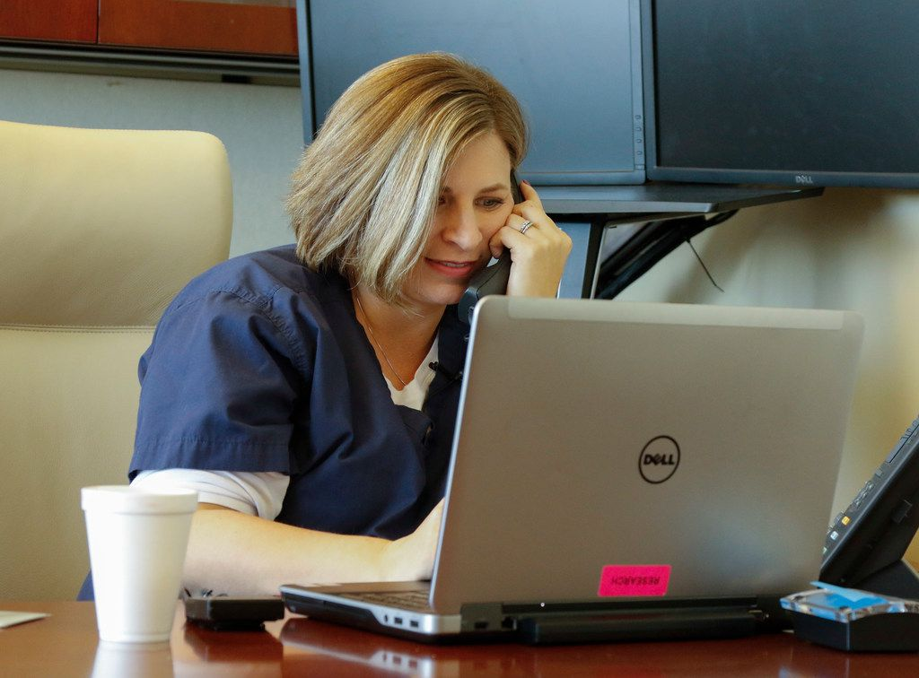 Kristin Posey Wallis, uterus transplant nurse, works to return phone calls to interested participants in Baylor's successful uterine transplant clinical trial. (Ron Baselice/Staff Photographer)