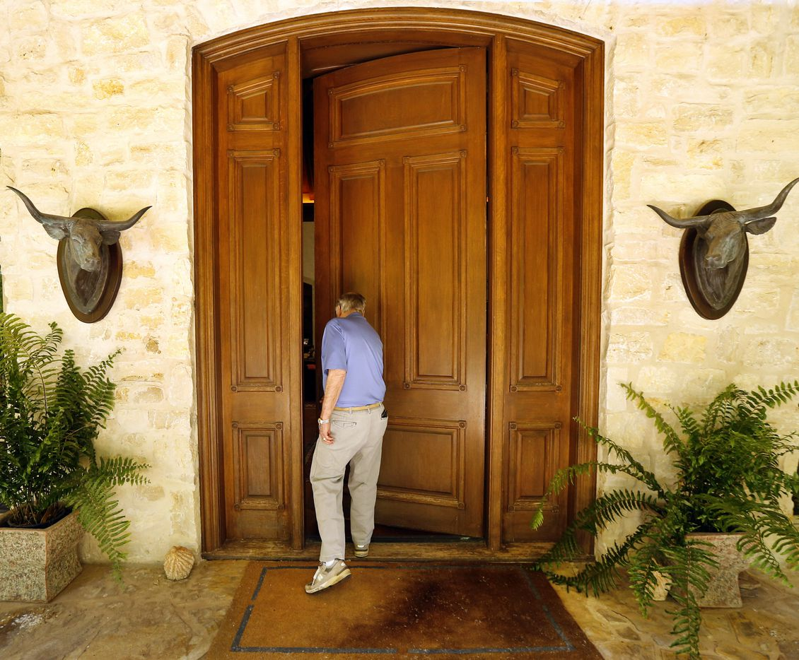 T. Boone Pickens enters the front door of the lodge, his residence on the Mesa Vista Ranch.