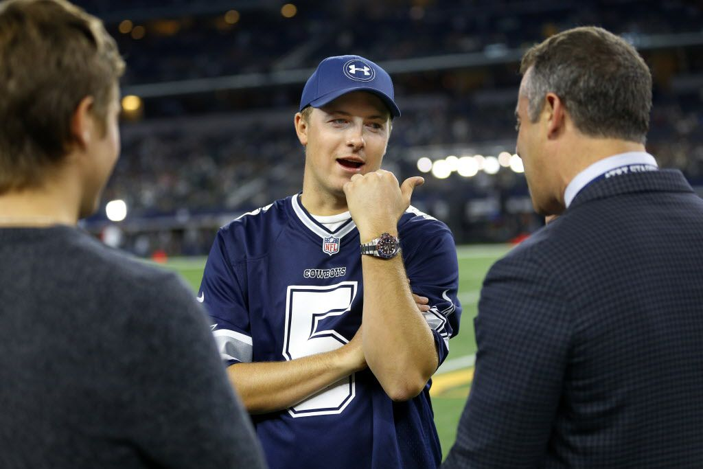 Wearing a Dallas Cowboys kicker Dan Bailey jersey, professional golfer Jordan Spieth of Dallas (center) visits with friends on the sideline before the Dallas Cowboys against the New York Jets  at AT&T Stadium in Arlington, Texas, Saturday, December 19, 2015. (Tom Fox/The Dallas Morning News)