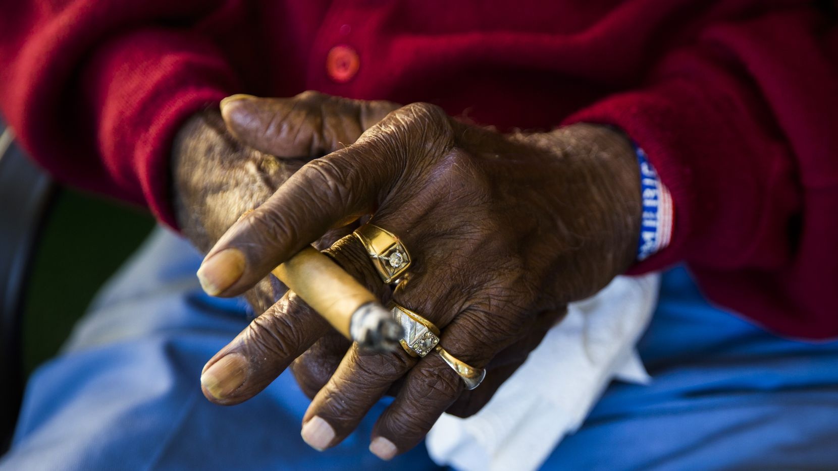 Richard Overton, 111, holds a cigar while sitting on his front porch on Thursday, May 25, 2017, in Austin. Overton is known for smoking cigars and drinking whiskey on his front porch. He is the oldest living U.S. war veteran.