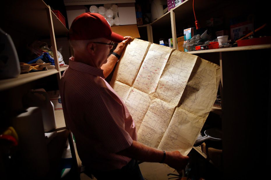 Central Compress & Warehouse Co. owner Mike Riley, of Muleshoe, Texas finds an old Texas agricultural map as he rummages through a closet at his large Sudan, Texas cotton compressing and storage business, Tuesday, August 1, 2017.  Mike, who is retiring and selling the business, is the proud father of new Oklahoma head football coach Lincoln Riley. (Tom Fox/The Dallas Morning News)