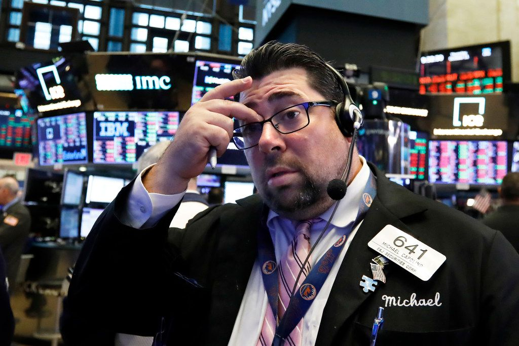 Trader Michael Capolino works on the floor of the New York Stock Exchange, Thursday, Oct. 11, 2018. The market's recent decline was set off by a sharp drop in bond prices and a corresponding increase in yields last week and early this week. (AP Photo/Richard Drew)