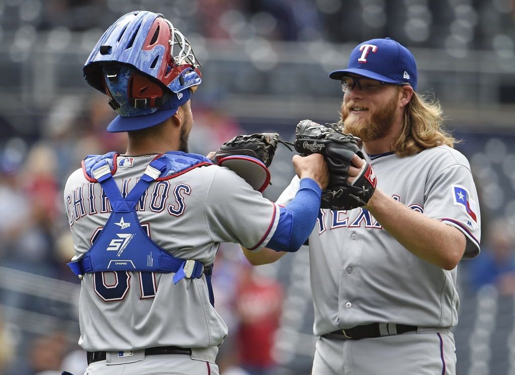 SAN DIEGO, CA - MAY 9: A.J. Griffin #64 of the Texas Rangers, right, is congratulated by Robinson Chirinos #61 after beating the San Diego Padres 11-0 in a baseball game at PETCO Park on May 9, 2017 in San Diego, California.  (Photo by Denis Poroy/Getty Images)