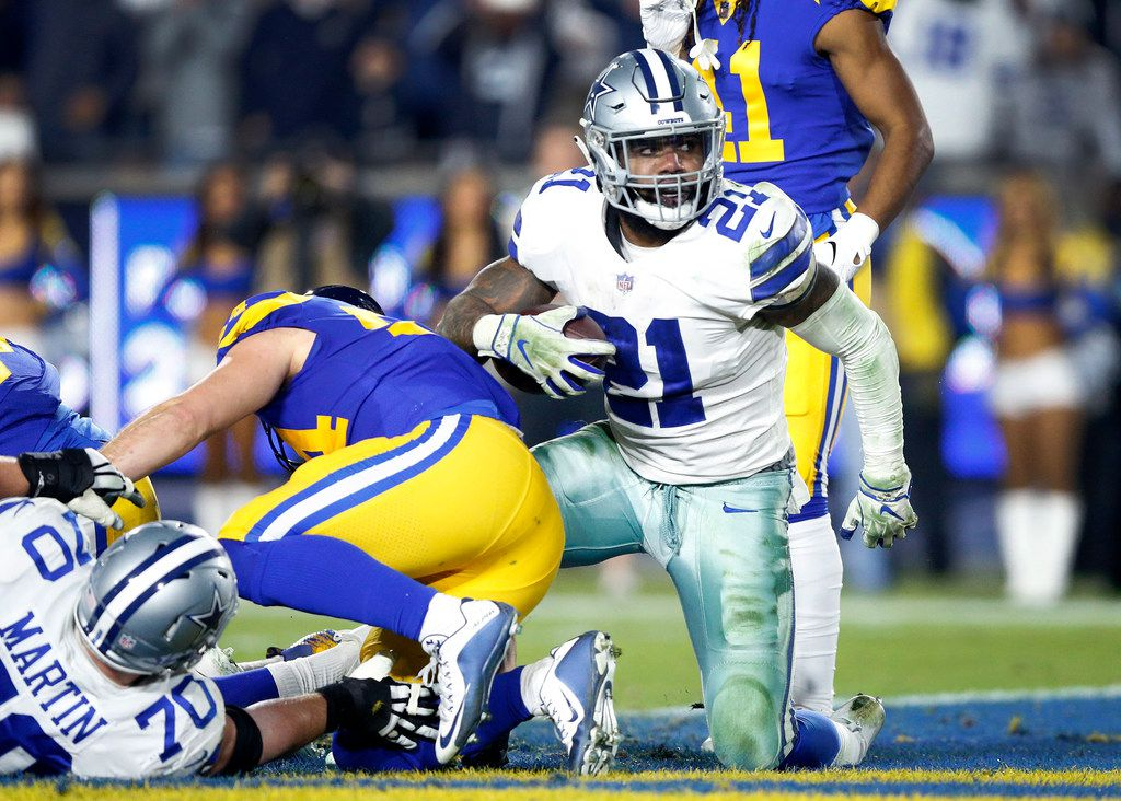 Dallas Cowboys running back Ezekiel Elliott (21) scores a third quarter touchdown against the Los Angeles Rams during their NFC Divisional Playoff game at Los Angeles Memorial Coliseum in Los Angeles, Saturday, January 12, 2019. The Cowboys lost 30-22. (Tom Fox/The Dallas Morning News)