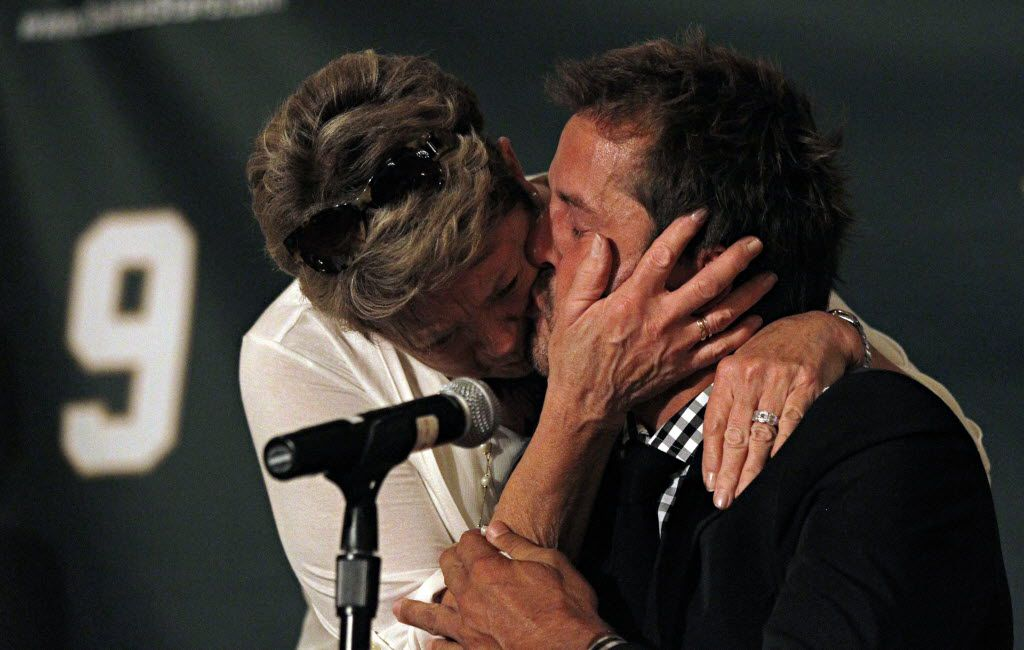 Former Dallas Stars player Mike Modano (right) kisses his mother, Karen Modano, after he became emotional during a press conference about his retirement from hockey Friday, September 23, 2011 at the Ritz Carlton Hotel in Dallas.