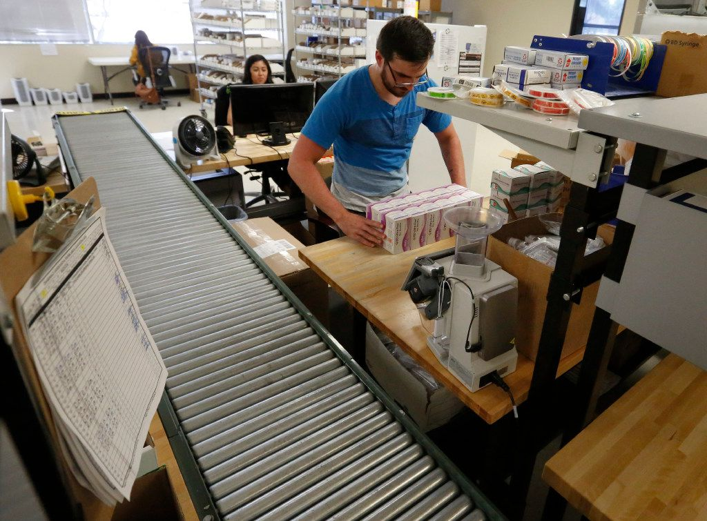 Certified Pharmacy Technician Kevin Strange prepares stock to be shipped at Senderra Specialty Pharmacy in Richardson . The company specialized in high-end drugs. (Ron Baselice/The Dallas Morning News)