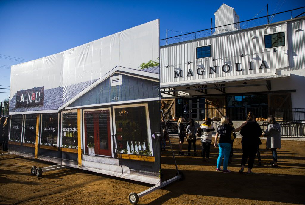 A large photo of the original store location stands outside the new location of Magnolia Market at the Silos, owned by Chip and Joanna Gaines, hosts of HGTV's Fixer Upper, on Thursday, October 29, 2015 at Magnolia Market at the Silos in Waco, Texas.   (Ashley Landis/The Dallas Morning News)  -- MANDATORY CREDIT, TV OUT, MAGS OUT, NO SALES, INTERNET USE BY AP MEMBERS ONLY