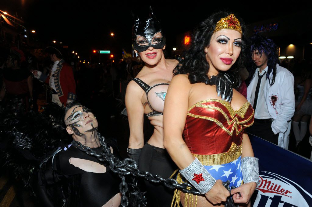 Eduardo Arryo gets subdued by Catwoman Barbara Lustro and Wonder Woman Pearl Diaz at the annual Halloween Block Party on Cedar Springs in Dallas, TX on October 26, 2013. (Alexandra Olivia/ Special Contributor)