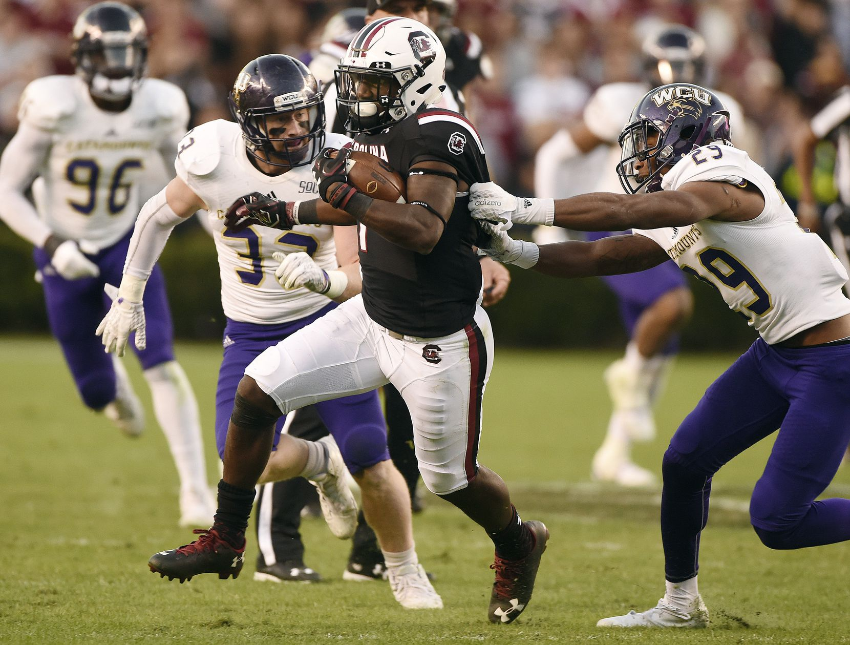 COLUMBIA, SC - NOVEMBER 19: Wide receiver Deebo Samuel #1 of the South Carolina Gamecocks breaks a tackle by defensive back Marvin Tillman #29 of the Western Carolina Catamounts on November 19, 2016 at Williams-Brice Stadium in Columbia, South Carolina.  (Photo by Todd Bennett/GettyImages)