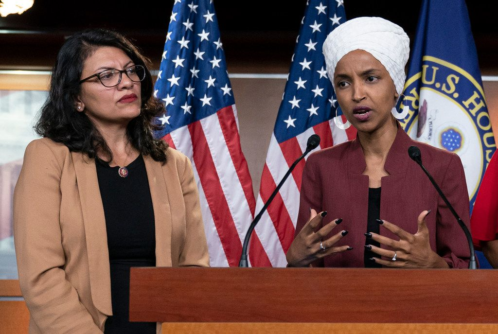 FILE - In this July 15, 2019, file photo, U.S. Rep. Ilhan Omar, D-Minn, right, speaks, as U.S. Rep. Rashida Tlaib, D-Mich. listens, during a news conference at the Capitol in Washington.