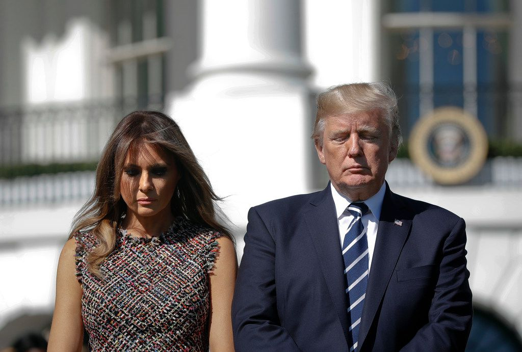 President Donald Trump and first lady Melania Trump stand during a moment of silence to remember the victims of the mass shooting in Las Vegas, on the South Lawn of the White House on Monday, Oct. 2, 2017.