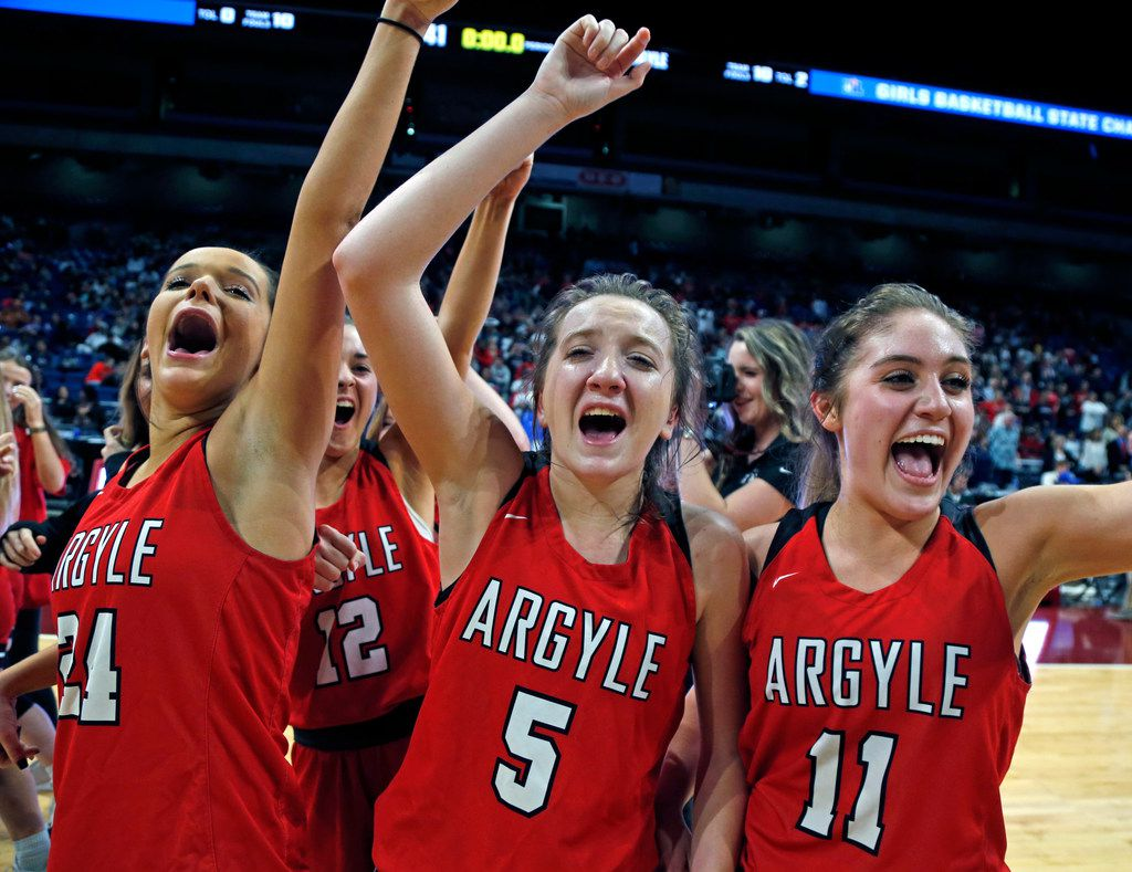 Argyle's Abby Williams,Argyle's Rhyle McKinney,C, and Argyle's Brooklyn Carl begin their celebration. UIL girls basketball 4A State final between Argyle and Hardin-Jefferson on Saturday,  March 2, 2019 at the Alamodome in San Antonio, Texas. (Ron Cortes/ Special Contributor) ORG XMIT: 10043975A